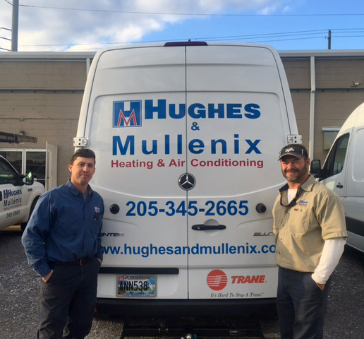 Two men with Hughes & Mullenix van